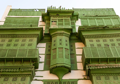 Old house with green wooden mashrabiya in al-Balad quarter, Mecca province, Jeddah, Saudi Arabia