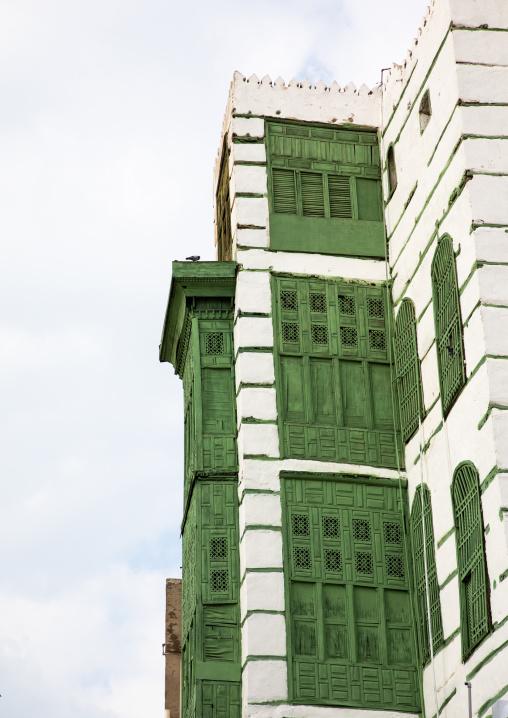 Old house with green wooden mashrabiya in al-Balad quarter, Mecca province, Jeddah, Saudi Arabia