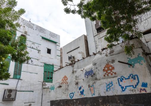 Space invaders art on the wall of a house, Mecca province, Jeddah, Saudi Arabia