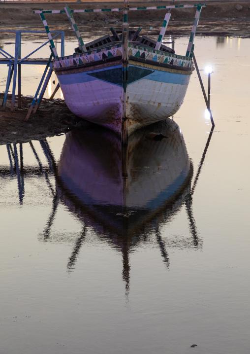 Wooden boat in a harbour at dusk, Jizan Province, Jizan, Saudi Arabia