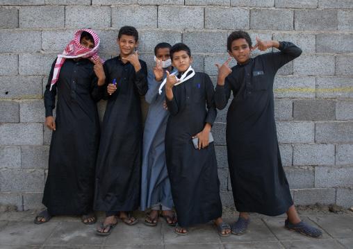 Portrait of farasani boys dressed in black, Red Sea, Farasan, Saudi Arabia