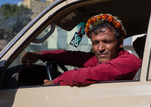 Portrait of a flower man wearing a floral crown on the head in his car, Jizan Province, Addayer, Saudi Arabia