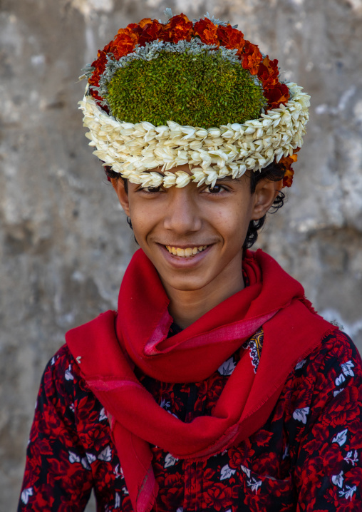 Portrait of a smiling flower boy wearing a floral crown on the head, Jizan Province, Addayer, Saudi Arabia