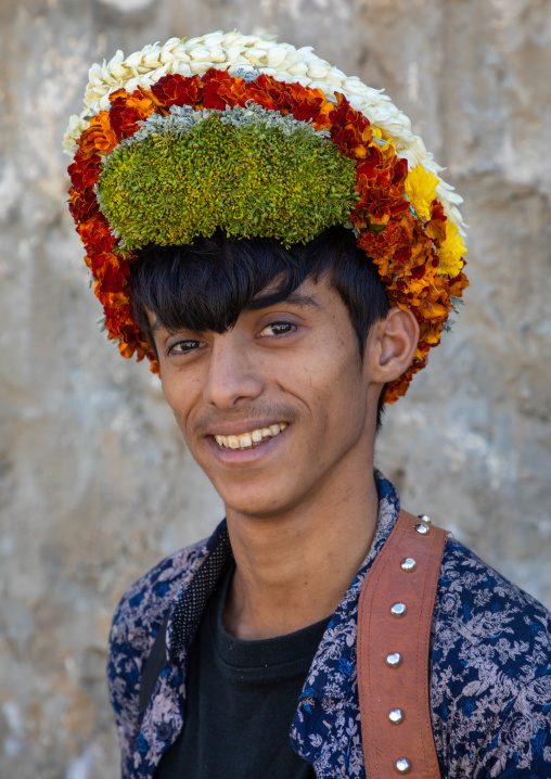 Portrait of a flower young man wearing a floral crown on the head, Jizan Province, Addayer, Saudi Arabia