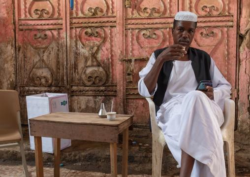 Sudanese man drinking coffee in a market, Jizan Province, Sabya, Saudi Arabia