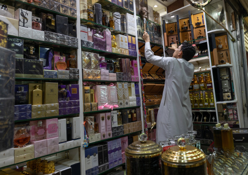 Saudi man cleaning his perfume shop, Jizan Province, Sabya, Saudi Arabia