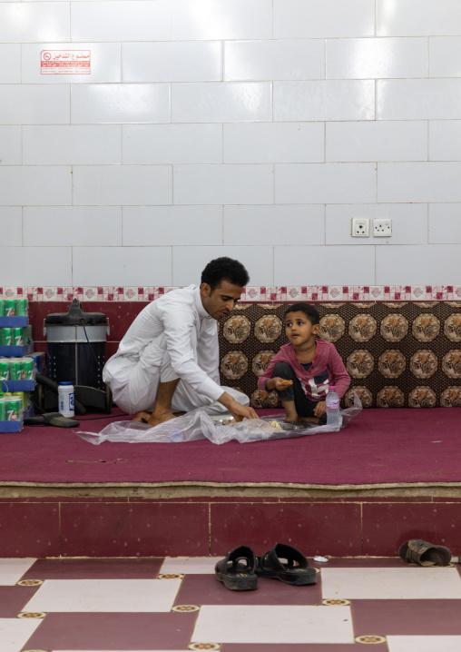 Saudi father and son eating in a local restaurant, Jizan Province, Sabya, Saudi Arabia