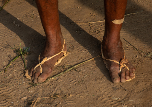 Old saudi man wearing traditional shoes made of palm leaves, Jizan Province, Mahalah, Saudi Arabia