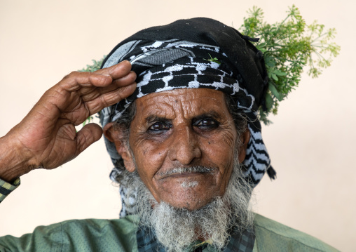 Portrait of a flower man wearing a floral crown on the head, Jizan Province, Mahalah, Saudi Arabia