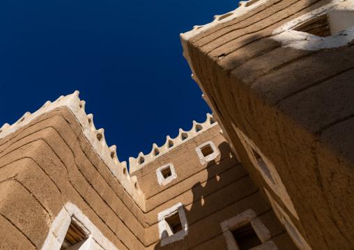 Traditional mud house against blue sky, Najran Province, Najran, Saudi Arabia