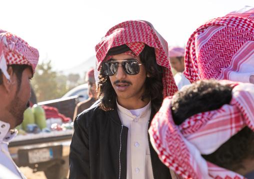 Saudi young men with keffiehs and sunglasses, Najran Province, Najran, Saudi Arabia