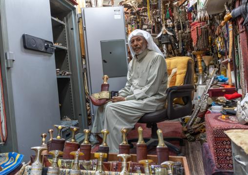 Saudi man holding a janbiya dagger kept in a safe, Najran Province, Najran, Saudi Arabia