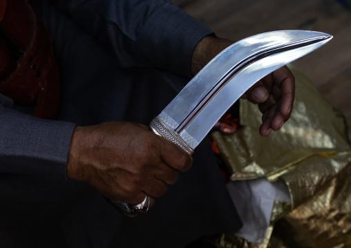 Saudi man holding a janbiya dagger blade, Najran Province, Najran, Saudi Arabia