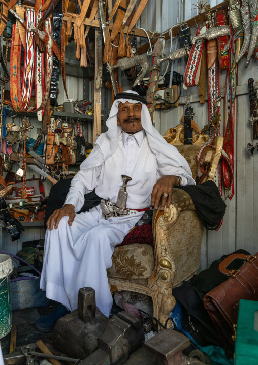 Old saudi man selling belts and  janbiya daggers, Asir province, Abha, Saudi Arabia