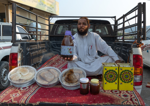 Saudi man selling honey and honeycombs on a market, Asir province, Al Habeel, Saudi Arabia