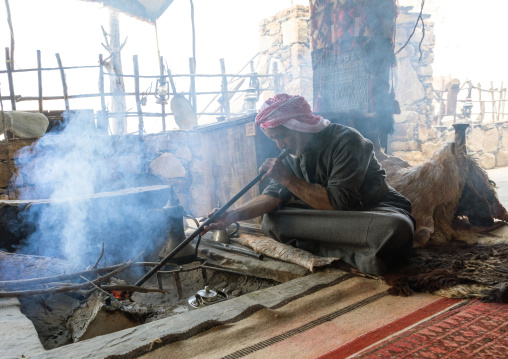 Saudi man blowing on fire in a majlis, Asir province, Tanomah, Saudi Arabia