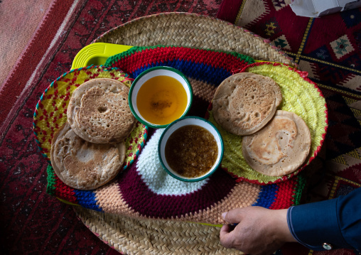 Bread with ghee and honey served to guests in a majlis, Asir province, Tanomah, Saudi Arabia