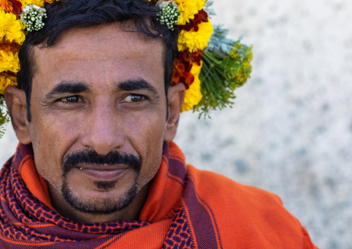 Portrait of a flower man wearing a floral crown on the head, Jizan Province, Addayer, Saudi Arabia