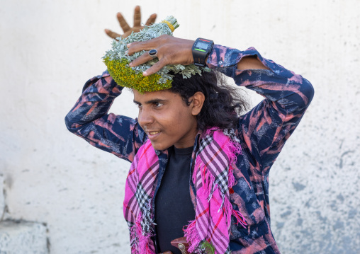 Portrait of a flower man making a floral crown on his head, Jizan Province, Addayer, Saudi Arabia