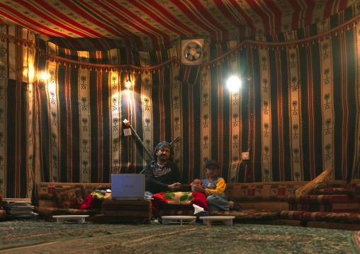 Saudi man inside a room decorated as a tent, Fifa Mountains, Al-Sarawat, Saudi Arabia