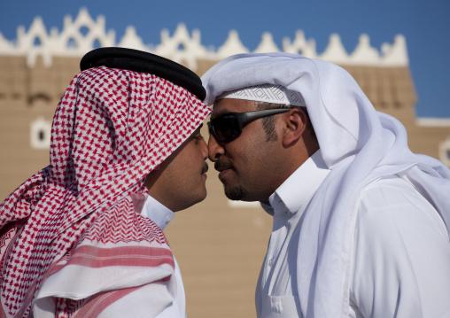Portrait of saudi men traditionally kissing on the nose, Najran Province, Najran, Saudi Arabia