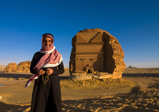Saudi Tourist In Front Of Nabatean Tomb In Madain Saleh Archaeologic Site, Al Madinah Province, Alula, Saudi Arabia