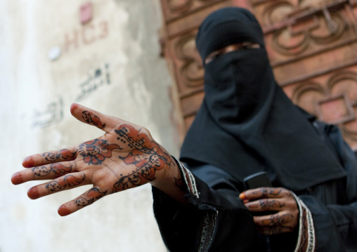 Somali refugee showing her hands tattooed with henna, Mecca province, Jeddah, Saudi Arabia