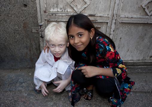 Albino indian boy with a girl, Mecca province, Jeddah, Saudi Arabia