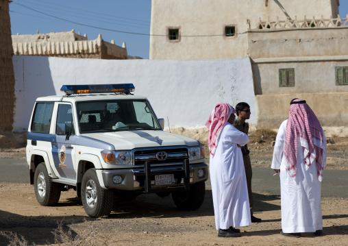 Police escort for tourists in a village, Najran Province, Najran, Saudi Arabia