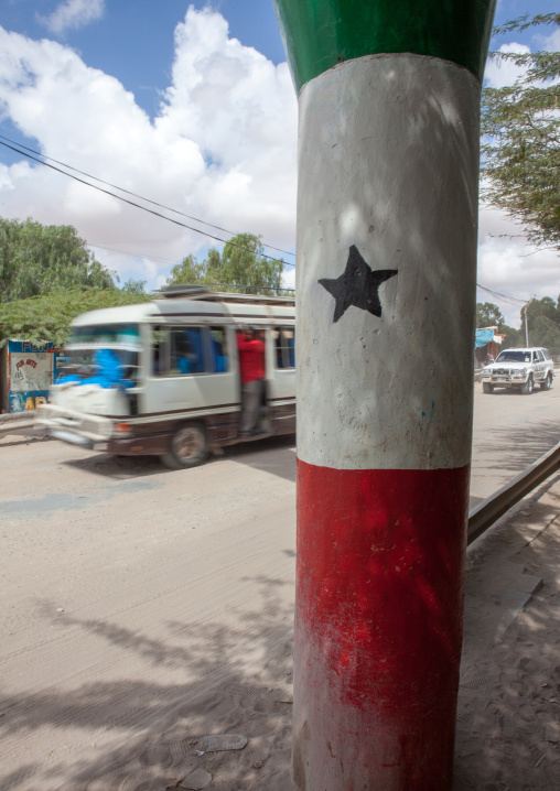 Bus passing in front of a pilar with the national flag, Woqooyi galbeed region, Hargeisa, Somaliland
