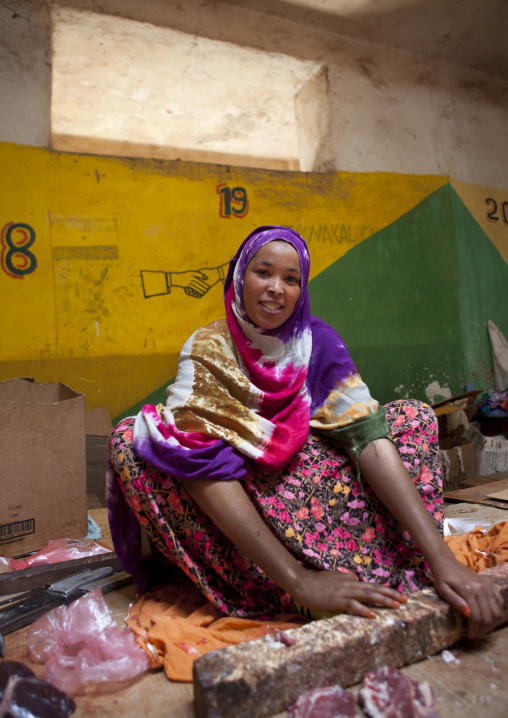 A woman sitting on the floor selling meat, Hargeisa market, Somaliland