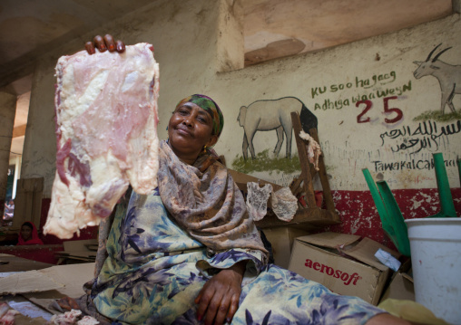 A Woman Meat Vendor Is Holding A Piece Of Livestock In Her Hand, Hargeisa, Somaliland