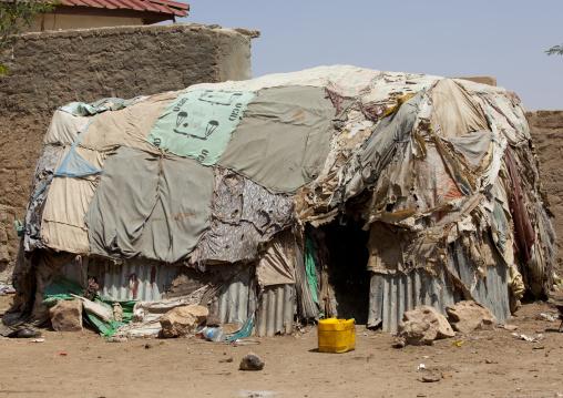 A slum hut made of corrugated iron and canvas,  Hargeisa, Somaliland