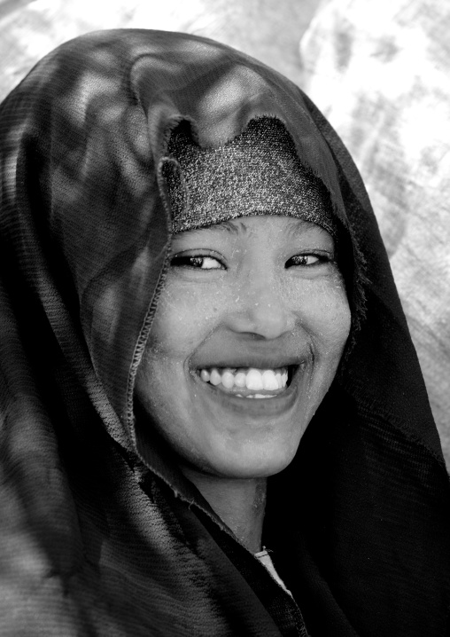 Portrait of a smiling young woman wearing quasil on her face