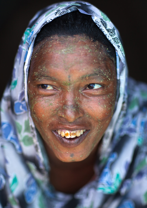 Portrait of a smiling somali woman with qasil on her face, Woqooyi galbeed region, Hargeisa, Somaliland