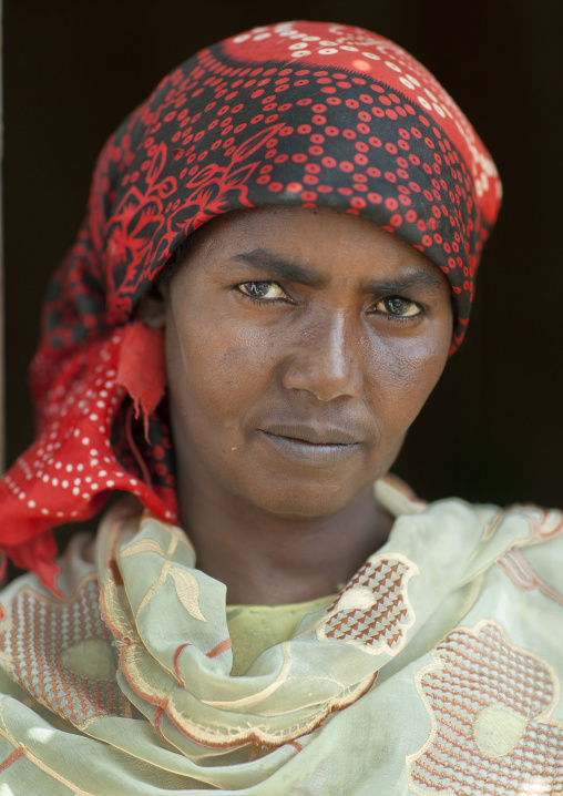 Portrait of a serious looking woman wearing a red hijab, Hargeisa, Somaliland