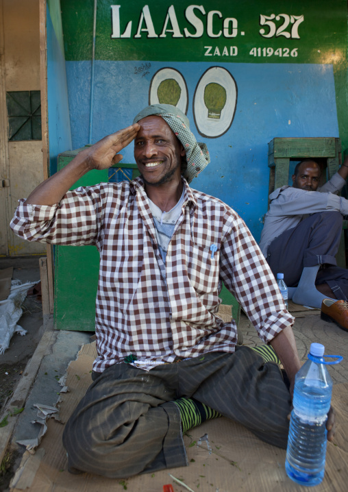 A smiling man sitting on a piece of cardboard, Hargeisa, Somaliland