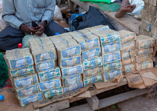 Wads of money changers on a stall in the street, Woqooyi galbeed region, Hargeisa, Somaliland