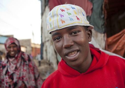 A teenage boy wearing an american fashion cap in a street of hargeisa, Somaliland