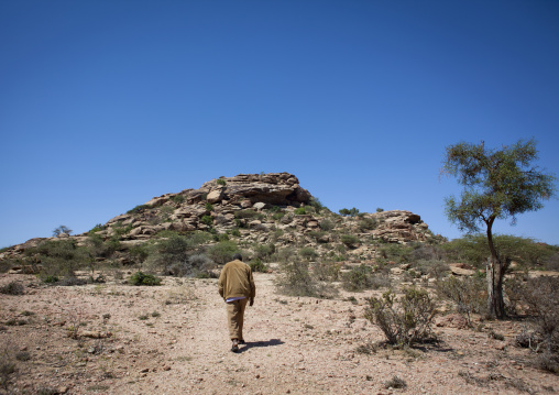 Landscape of the las geel area, Backside of a man walking, Somaliland