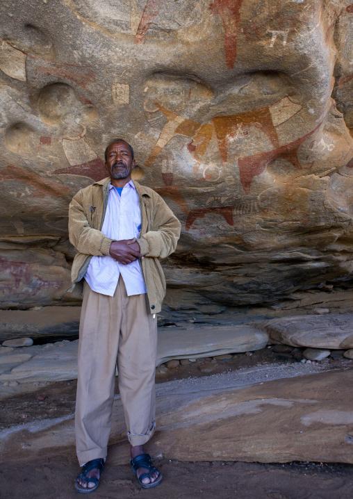 Laas geel rock art caves, Guide standing in the cave, Hargeisa, Somaliland