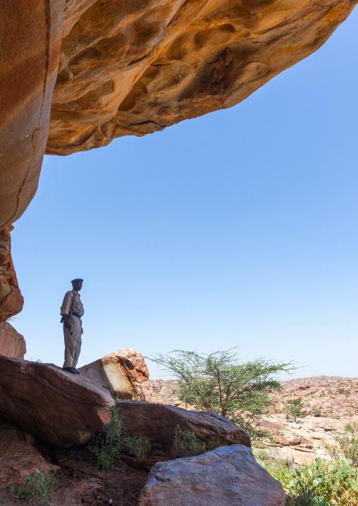 Police escort in laas geel rock art caves, Woqooyi galbeed region, Hargeisa, Somaliland