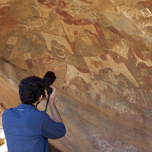 Backside of westerner taking pictures, Laas geel caves, Hargeisa, Somaliland