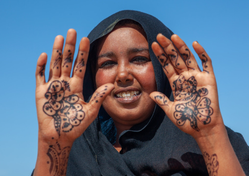 A somali woman showing her hand painted with henna, North-western province, Berbera, Somaliland