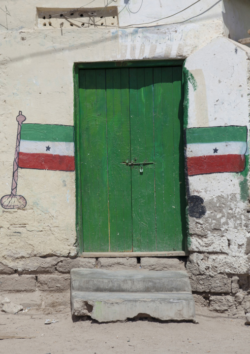 Two Flags Painted On The Wall Around A Green Door, Berbera, Somaliland