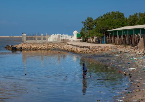 Somali woman having a bath in the red sea, North-western province, Berbera, Somaliland