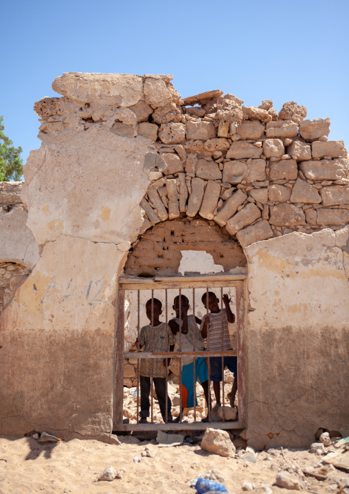 Three somalis boys in the ruins of an old ottoman house, North-western province, Berbera, Somaliland