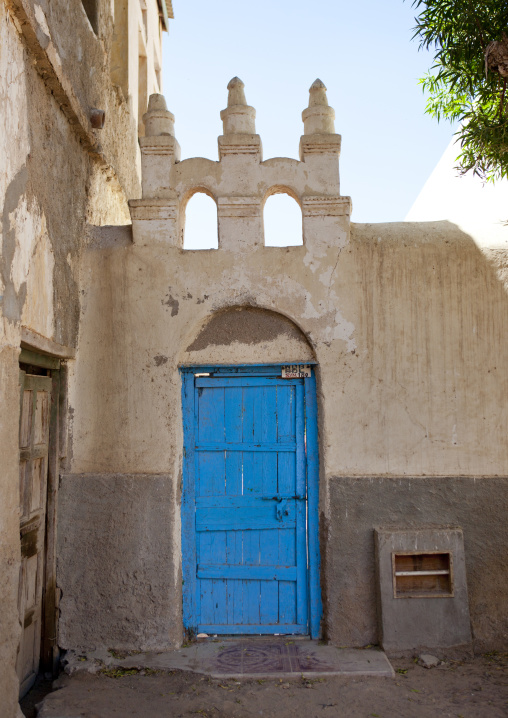 Inside patio and blue door of a well conserved former ottoman house, Berbera,  Somaliland