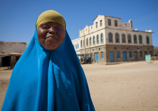 Portrait of a teenage girl outside a former ottoman empire house, Berbera area, Somaliland