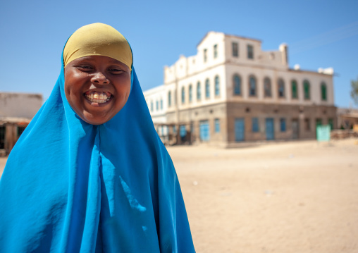 Smiling somali girl  in front of  a former ottoman empire house, North-Western province, Berbera, Somaliland